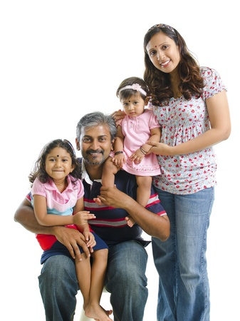 adult indian: Happy modern Indian family portrait on white background