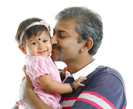 Mature Indian father kissing baby girl, isolated on white background photo