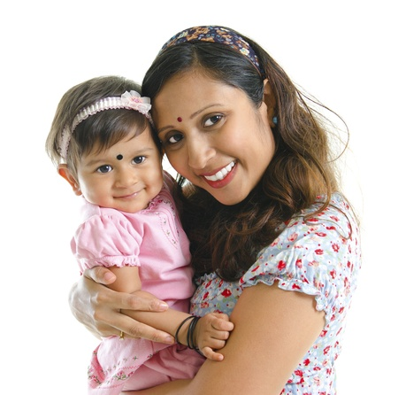 Happy modern Indian mother hugging her daughter isolated on white background photo