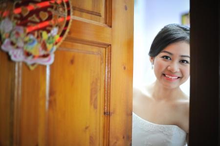 Beautiful bride open door for groom photo