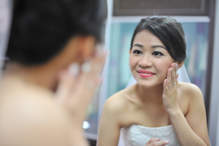 getting a bride: Bride preparing for the wedding ceremony Stock Photo