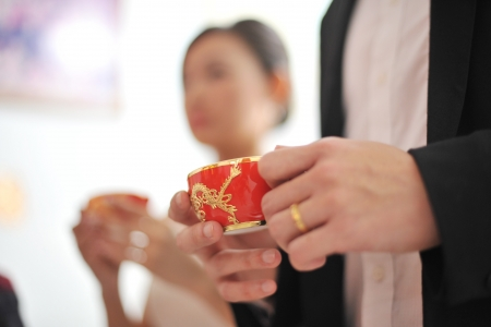 Traditional Chinese wedding tea ceremony, focus on teacup photo