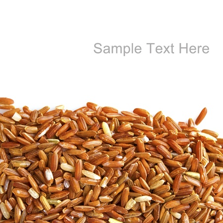 Red rice on white background with copy space on top photo