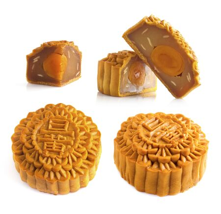 traditionally: Mooncake traditionally eaten during the Mid-Autumn Festival. Chinese words on the mooncake means single yolk. Stock Photo