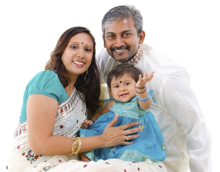 pakistani females: Traditional Indian family with one child sitting on white background Stock Photo