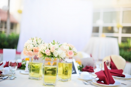Outdoor banquet wedding table setting, shallow depth of field photo