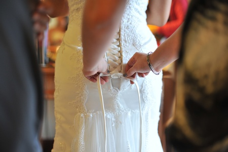 tied girl: Bridesmaid assist to tied up wedding dress