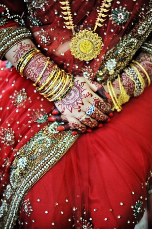 Indian bride with beautiful henna on her wedding day photo