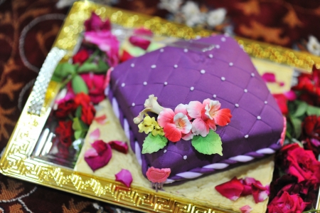 Colorful Indian style wedding cake photo