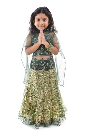 sari: Cute little Indian girl in a greeting pose, isolated white background