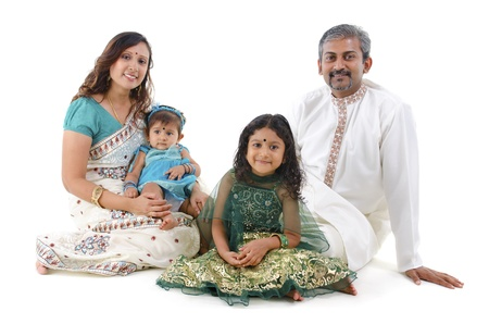 saree: Happy Indian family sitting on white background Stock Photo