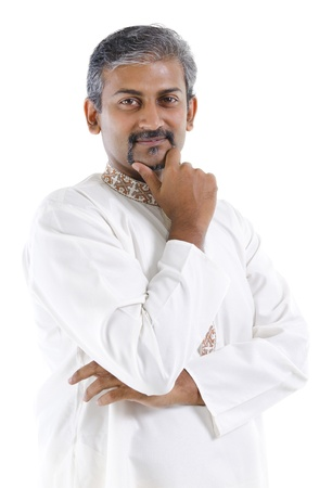 Confident mature traditional Indian man in kurta dhoti isolated on white background photo