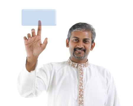 Mature Asian Indian business man pointing on virtual screen button photo