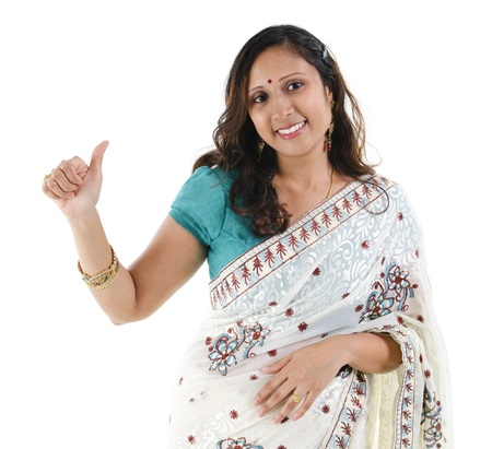 indian saree: Beautiful Indian woman showing thumb up hand sign on white background