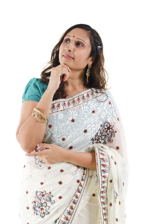 Beautiful Indian woman having a thought, isolated white background photo
