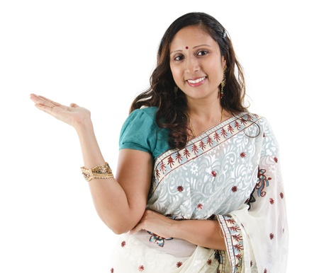 saree: Cheerful traditional Asian Indian woman arm out showing empty space, isolated on white