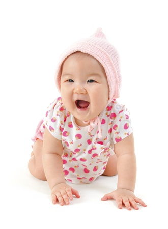 Six months old Asian mixed race baby girl crawling over white background. photo