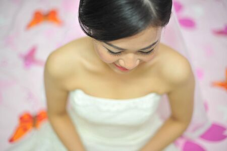 bridal makeup: Beautiful Asian bride on her wedding day