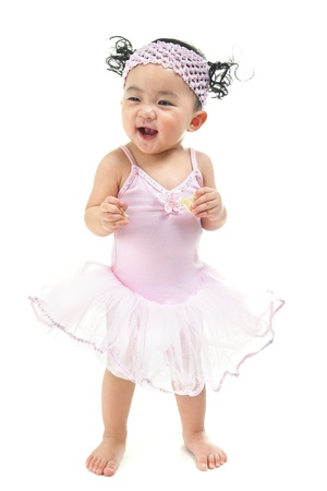 One year old Asian baby girl standing over white background photo