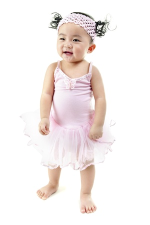One year old pan Asian baby girl learn walking on her own photo