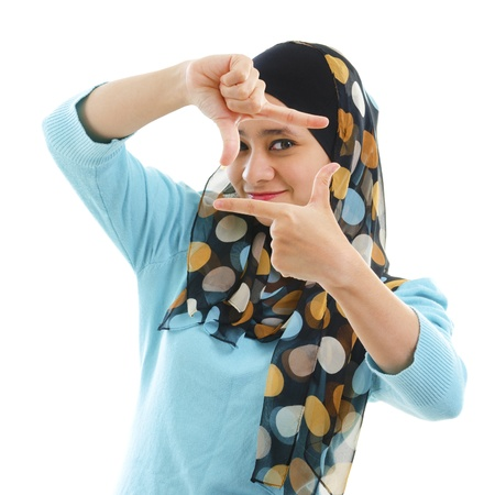 Smiling Asian Muslim woman making a frame with fingers photo