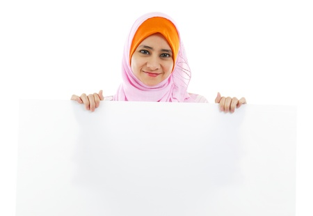 Young Muslim woman holding a white board photo
