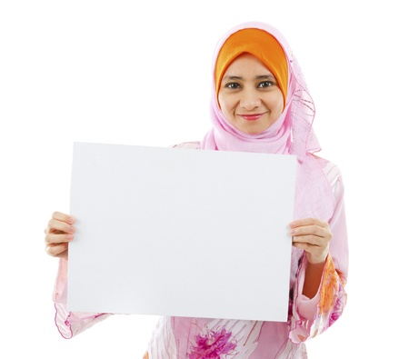 malay: Beautiful Young Muslim girl holding a white card board over white background
