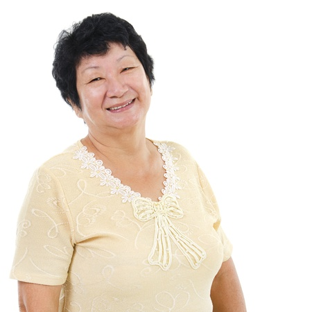 60s Asian senior woman smiling over white background photo