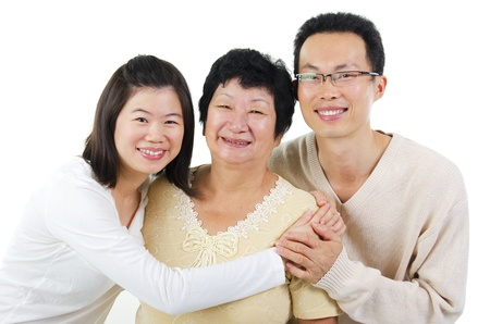 offsprings: Asian senior mother and adult offsprings over white background Stock Photo