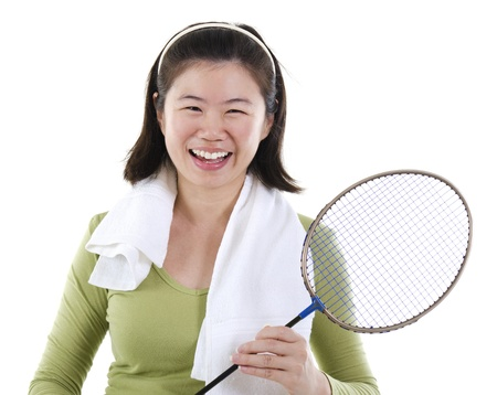 badminton racket: Happy Asian female holding badminton racket over white background