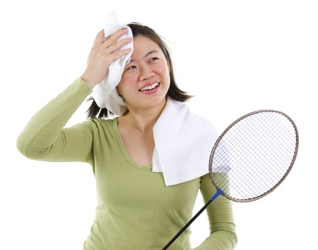 Asian female sweating after playing badminton game, over white background photo