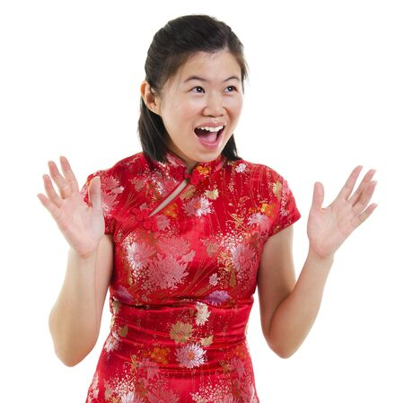 Happy oriental woman open her arms with surprising face over white background photo
