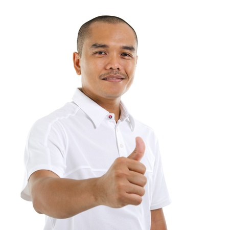 Thumb up good looking mature Southeast Asian man over white background Stock Photo - 14639774