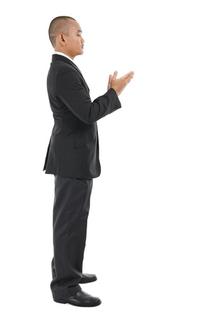 Male Muslim prayer in full business suit praying over white background photo