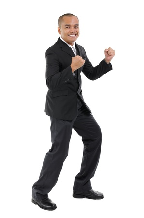 Excited Southeast Asian business man, fullbody over white background photo