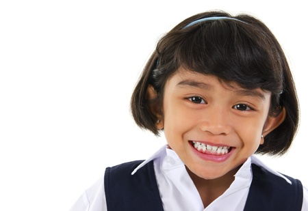Head shot portrait of Southeast Asian primary school student over white background photo