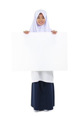 Fullbody Southeast Asian teen holding a blank card board over white background photo