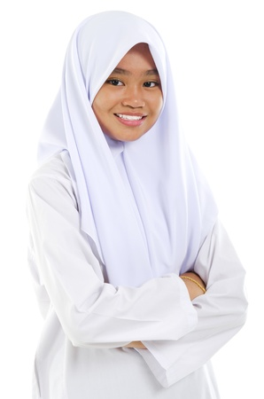 malay ethnicity: Portrait of a Southeast Asian Muslim teen crossed arms over white background