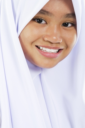 Twelve years old Southeast Asian Muslim girl portrait photo