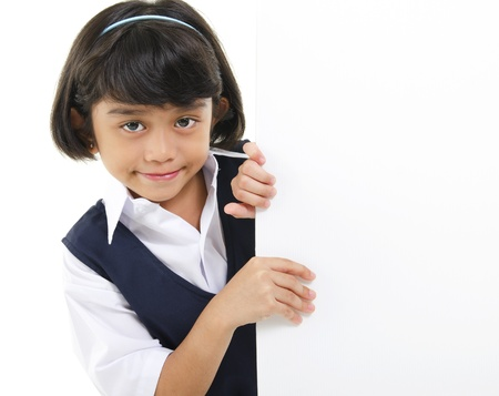Southeast Asian schoolgirl hiding behide a white board photo