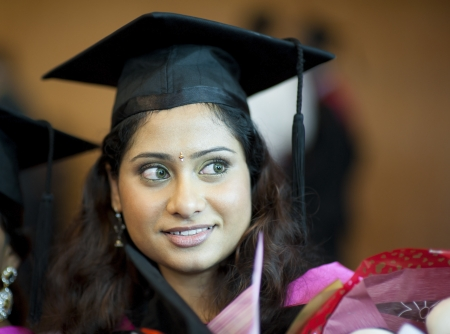 Happy Asian Indian female student in her graduation day photo