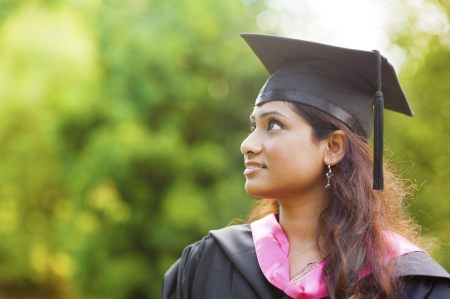 Smiling Young Asian Indian female student looking away with copy space photo