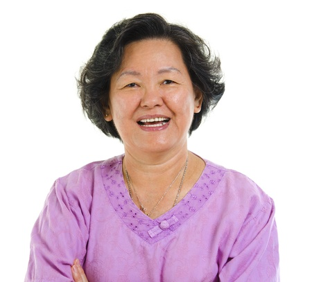60s cheerful Asian senior woman smiling over white background