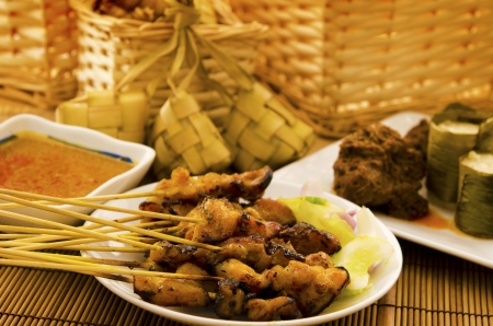 Asian malay Ramadhan foods, satay chicken, rendang, lemang and ketupat photo