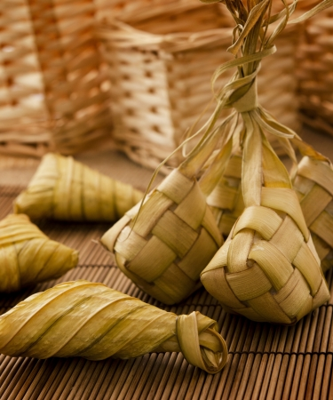 Asian cuisine ketupat or packed rice in low light setting. photo