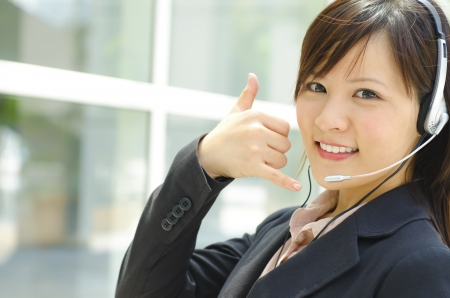call center female: Friendly Customer Representative with headset. Stock Photo