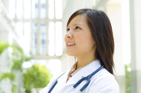Young Asian medical student smiling and looking away photo