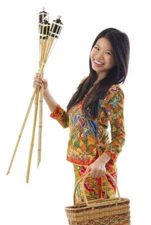 raya: Happy young Malay woman ready to celebrate Hari Raya Aidilfitri  Eid ul-Fitr Stock Photo