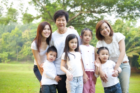 multiple family: Asian family portrait at outdoor park, 3 generations.