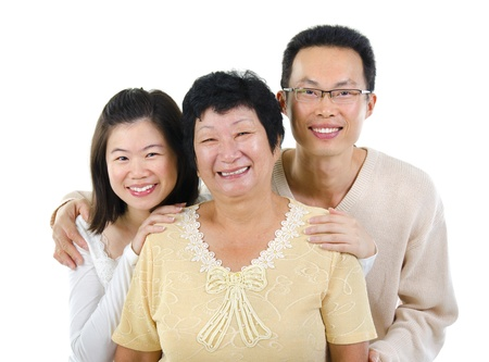 offspring: Asian senior mother and adult offspring over white background Stock Photo